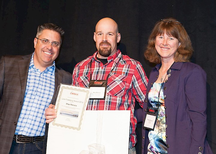 Mike Manara accepts the 2015 Lars Fossberg Award from Steve Paccagnan, left, and Hildur Sinclair during a CWSAA presenttion in Whistler earlier this year.